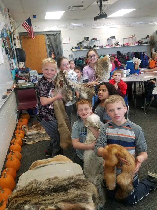 fourth graders learning about animal pelts