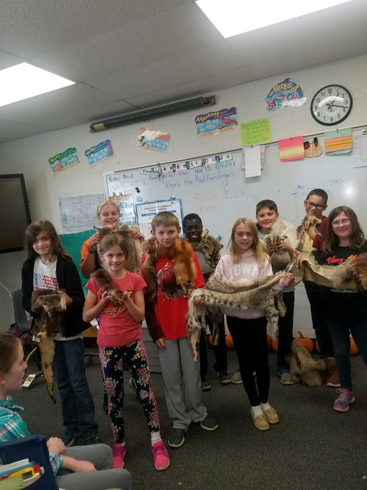 4th graders learning about animal pelts